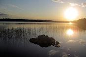 Ondergaande zon bij camping Metsäkarto