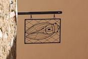 Uithangbord met cicade